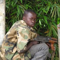 GANGLAND, USA: HOW AFRICAN CHILD SOLDIERS RESEMBLE AMERICAN GANG MEMBERS
